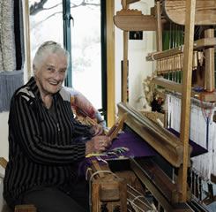 Peg weaving on her Oxaback 41 shaft draw system damask loom